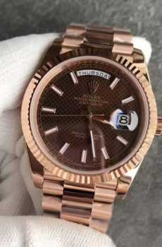 Rolex Daydate rose gold brown face