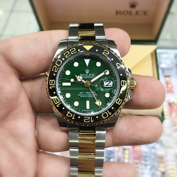 Rolex gmt green dial two tone